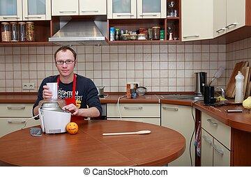 Man in a kitchen