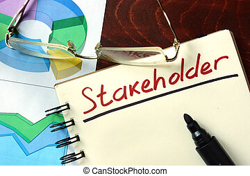 Stakeholder - Notepad with Stakeholder on the wooden table.