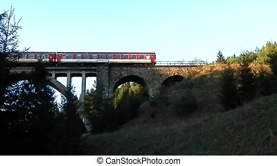 Passenger train viaduct and tunnel - By train and a...