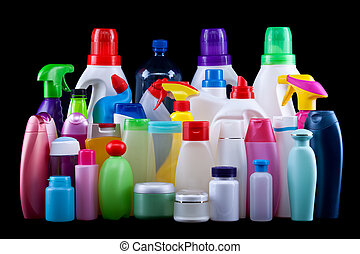Usual plastic bottles from a household isolated on black -...