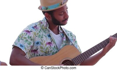Macho plays the guitar. Guitarist plays guitar and sings....