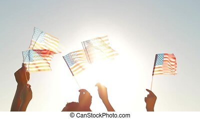 People waved American flags. Patriots with American flags....