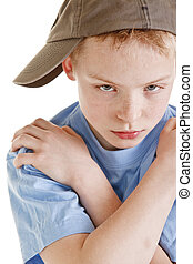 Tough looking young boy wearing a ball cap - Portrait of...