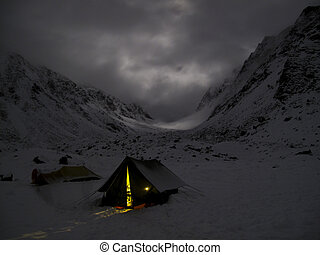 Isolation - A group of hikers set up camp for the night in a...
