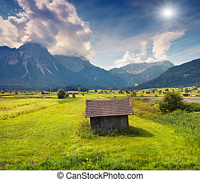Colorful summer morning on the Golf club Zugspitze near the...