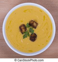 Apple pumpkin cream soup in a dish Close up