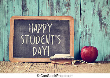 text happy students day in a chalkboard - the text happy...