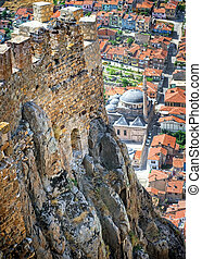 Karahisar castle walls on a hill over the old city of Afyon,...