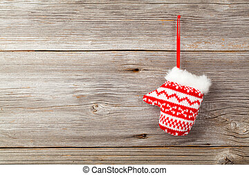 Red mitten on wooden background