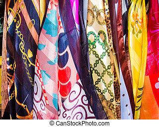 Scarves - Variety of multicolored hanging scarves in Paris...