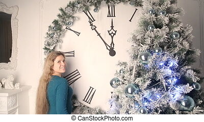 Girl sets the clock to new year - Girl sets the big...