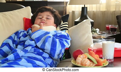 Sick child with neck brace - Tired,painful little boy with a...