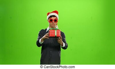Happy handsome brutal man with a gift. green screen
