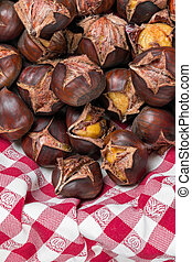chestnuts open on a red cloth