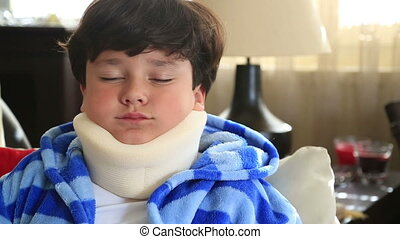 Sick child with neck brace - Portrait of a painful little...
