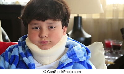 Sick child with neck brace - Portrait of a sad little boy...