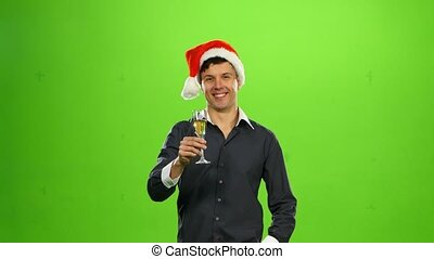 Happy smiling new years man with glass of champagne. green...