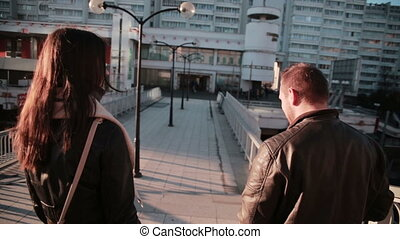 Young couple talking in city - Young couple Man and woman...