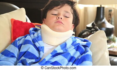 Sick child with neck brace - Portrait of a unhappy little...