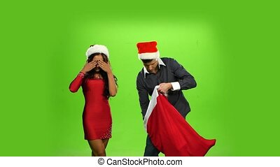 beautiful happy christmas holiday couple, gift box present. green screen