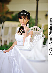 Brunette bride with original hair dress