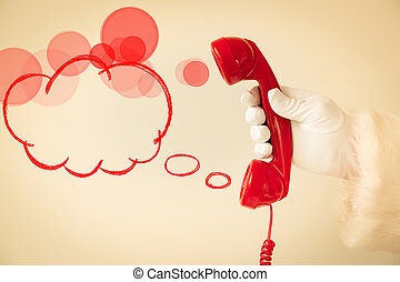 Santa Claus holding retro phone