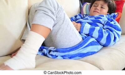 Child  with bandage on leg, laying