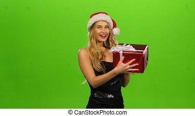 woman in Christmas cap with gift. green screen
