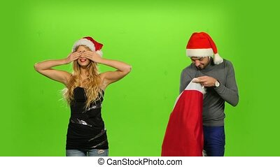 beautiful holiday couple, gift box present. green screen. new Year