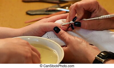 Manicure treatment. Paint and polish. - Nail paint and...