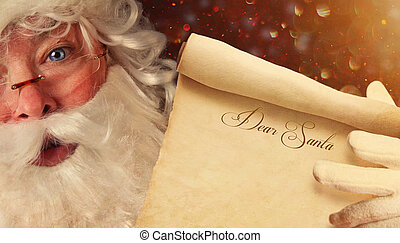 Closeup of Santa holding a Dear Santa scroll - Closeup of...