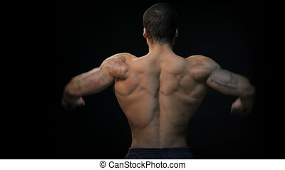 Gorgeous muscular bodybuilder back. Muscular man...