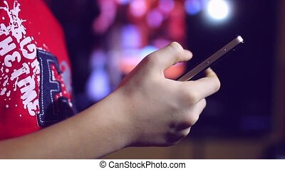Hand holding smartphone explores social media networks beautiful bokeh night
