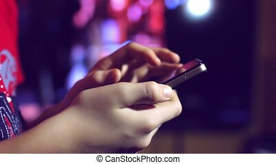 hand holding social media smartphone explores networks beautiful bokeh night