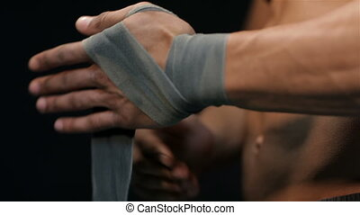 Man pulls the belt on the hand side view