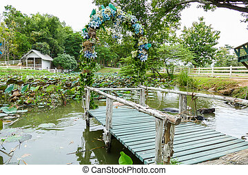 view of the wooden pier decorating with blue flower and...