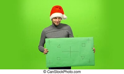 brutal man in Christmas hat green screen, blank sign -...