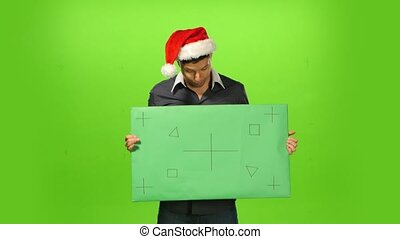 Happy man in Christmas hat green screen, blank sign -...