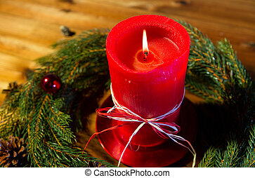 fir branch wreath with candle on wooden table - christmas,...