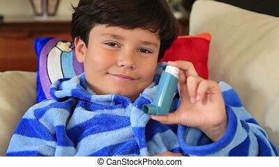 Child with asthma inhaler - Little boy showing his inhaler