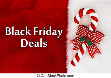 Black Friday Deals, Red Plush background and a Candy Cane...