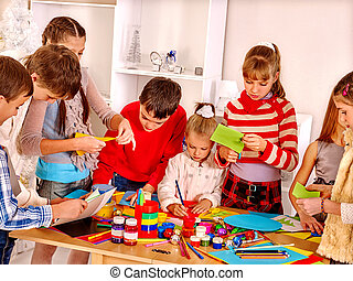Children painting at art school. - Group kids painting at...