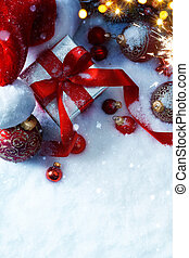 art Christmas balls and Christmas gift box on snow background