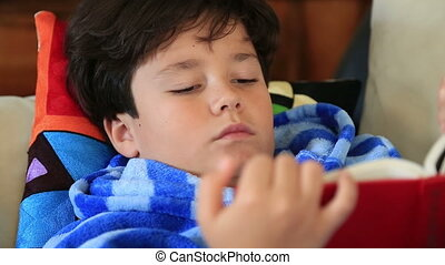 Young boy lying on a couch