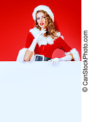 copy space - Attractive Christmas girl posing with a white...