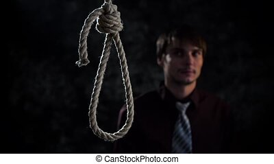 businessman with noose knot or failure. man commit suicide...