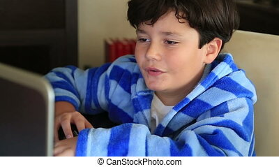 Young boy using computer