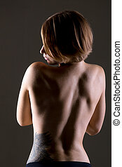 Young woman bare back