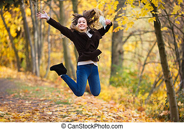 The first teenager's pay - Happy young smiling girl jump...
