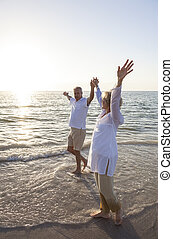 Senior Man & Woman Couple Sunset on Beach